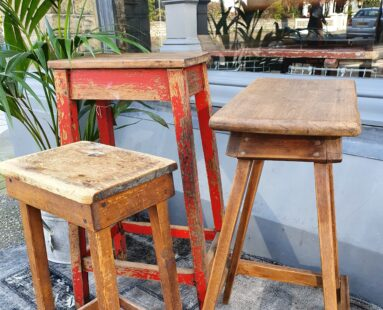 three wooden stools seating stools