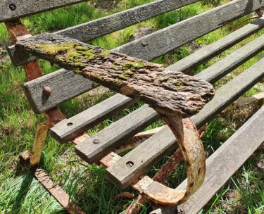 rustic wooden slatted bench with metal frame garden furniture